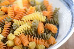 Uncook Italian raw fusilli pasta Stock Photo