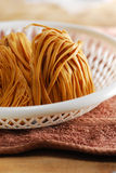 Uncook noodle coil Stock Photography