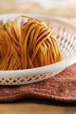 Uncook noodle coil. Uncook dry noodle coil pasta Stock Photography