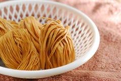 Uncook noodle coil Stock Images