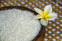 Uncook rice in the bamboo basket Royalty Free Stock Photography