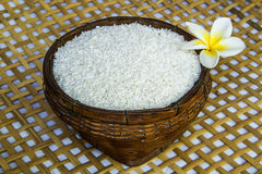 Uncook rice in the bamboo basket Stock Photography