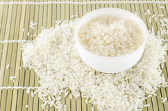 Uncook rice in mini bowl Royalty Free Stock Photography