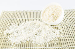 Uncook rice in mini bowl Stock Photography