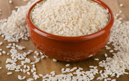 Uncooked arborio rice. In a clay bowl. Selective focus Stock Photography