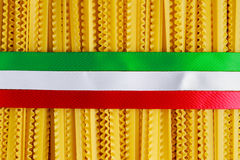 Uncooked Authenric Tripoline spaghetti pasta with italian flag style ribbons Stock Photos