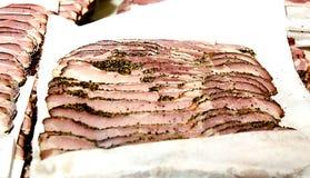 uncooked bacon Arkivfoto