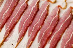 Uncooked Bacon. Pattern Background Material royalty free stock images