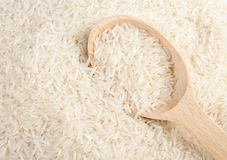 Uncooked basmati rice. In a wooden spoon Royalty Free Stock Photo