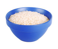 Uncooked basmati rice in a ceramic blue bowl Royalty Free Stock Images