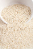 Uncooked basmati rice in a ceramic bowl Royalty Free Stock Photos
