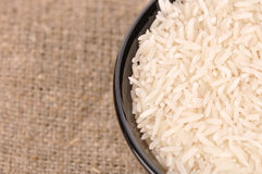 Uncooked basmati rice in a ceramic bowl Stock Photo
