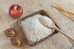 Uncooked Basmati rice in a wooden cup Stock Photo
