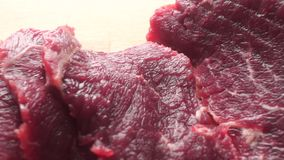 Uncooked beef close up dolly shot. Raw beef close up dolly shot clip stock footage
