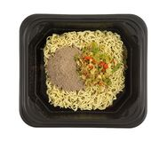 Uncooked beef flavored ramen noodles in a black tray Stock Image