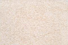 Uncooked białych ryż tło Zdjęcia Stock