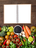 Uncooked black lentils in a bowl with vegetables Royalty Free Stock Photography