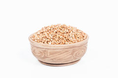 Uncooked buckwheat in a dish Royalty Free Stock Images