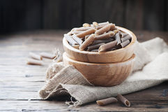 Uncooked buckwheat pasta on the wooden table Royalty Free Stock Photography