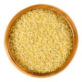 Uncooked bulgur or burghul in wooden bowl Stock Photography