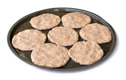 Uncooked burgers Royalty Free Stock Photography