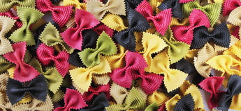Uncooked butterfly colorful pasta panorama Stock Photography