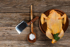 Uncooked  chicken on a old wooden table, top view. Whole raw chicken on a old wooden background with copy-space, top view Royalty Free Stock Image