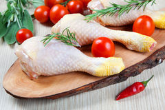 Uncooked chicken thigh -raw - chicken with vegetables Royalty Free Stock Images