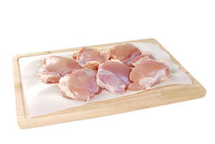 Uncooked chicken thighs. Raw boneless chicken thighs on a cutting board Stock Photography