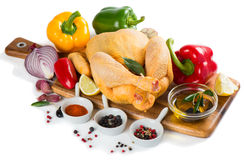Uncooked chicken with vegetables Royalty Free Stock Photos