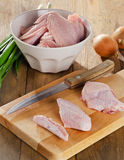 Uncooked  chicken wings on a chopping board.  Stock Photography