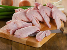 Uncooked  chicken wings on   wooden board Royalty Free Stock Photo