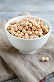 Uncooked chickpea in a white bowl Stock Image