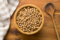 Uncooked chickpeas in bowl Stock Image