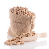 Uncooked chickpeas and wooden scoop Royalty Free Stock Photography