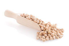 Uncooked chickpeas and wooden scoop Royalty Free Stock Photos