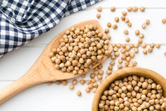 Uncooked chickpeas on wooden spoon Royalty Free Stock Photos