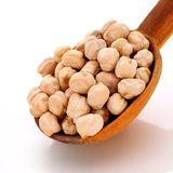Chickpeas in wooden spoon royalty free stock photos