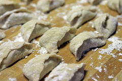 Uncooked Chinese dumplings. Many uncooked Chinese dumplings sitting on a table Royalty Free Stock Photography