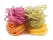 Uncooked colorful pasta Stock Photos