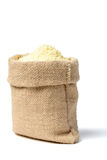 Uncooked corn flour in sack Royalty Free Stock Images