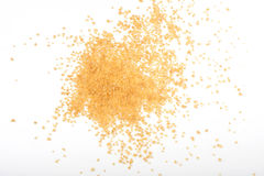 Uncooked couscous scattered on white background Royalty Free Stock Photos
