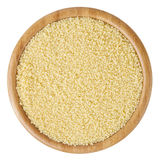 Uncooked couscous in wooden bowl isolated on white background. With clipping path royalty free stock images