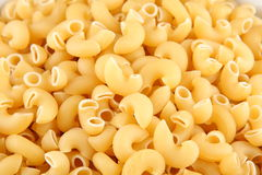 Uncooked  dry Italian pasta. Royalty Free Stock Photo