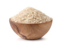Uncooked dry rice in wooden bowl Stock Photography