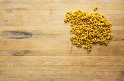 Uncooked Elbow Macaroni on Cutting Board Stock Image