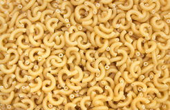 Uncooked elbow pasta background Royalty Free Stock Images