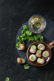 Uncooked Escargots de Bourgogne snails Stock Photo