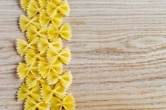 Uncooked farfalle pasta background Stock Images