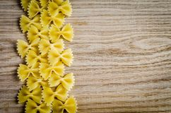 Uncooked farfalle pasta background Royalty Free Stock Images